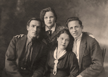 sepia.: A vintage photo portrait from 1954 of Russian family.