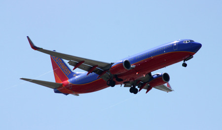 descending: San Diego, California, USA - May 26,2014: American Airlines jet descending for landing San Diego International Airport on May 26, 2014.