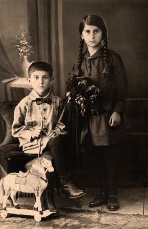 armenian woman: Vintage portrait of two children circa 1915. Editorial