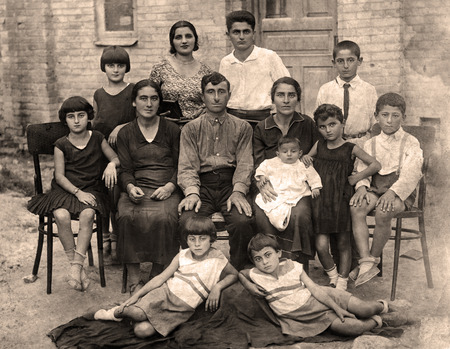 origin of man: Family portrait, people of all ages, circa 1930.