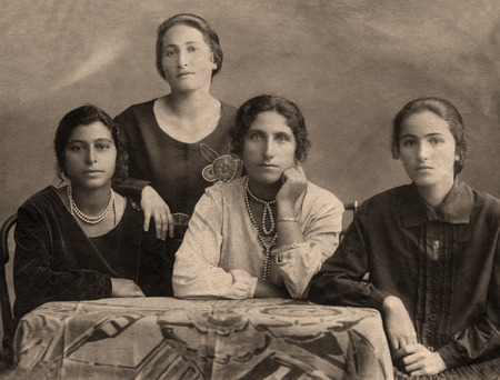 family history: A vintage photo portrait from 1914 of Gypsy family.