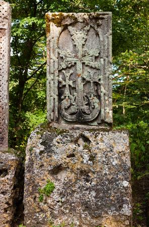 armenian: Ancient khachkar (cross stone) in armenian monastery. Stock Photo