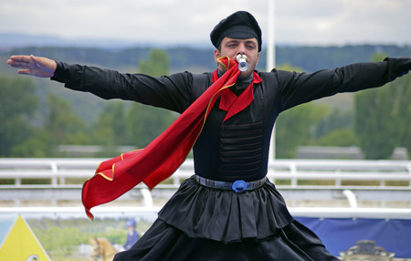 highlanders: PYATIGORSK,RUSSIA - SEPTEMBER 25,2016:Unknown member of the popular band Zolotoe runo performs the dance highlanders,hippodrome in Pyatigorsk,Caucasus,Russia on September 25,2016. Editorial