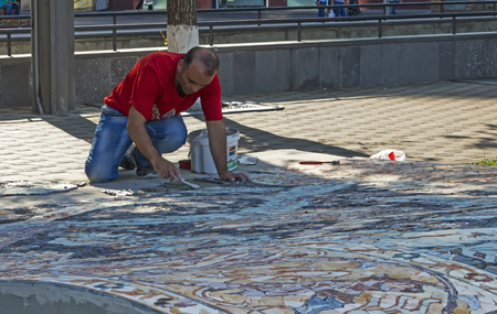 YEREVAN, ARMENIA - SEPTEMBER 19,2017 :Unknown artist painting a picture in a park town in Yerevan,Armenia.
