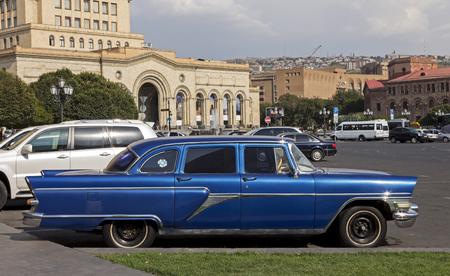 YEREVAN, ARMENIA - SEPTEMBER 17,2017 :Vintage soviet blue car Chaika in the historic center of the city. Editorial