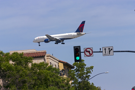 San Diego, California, USA - May 18,2014: A Delta Airlines jet approaches San Diego International Airport on May 18,2014.