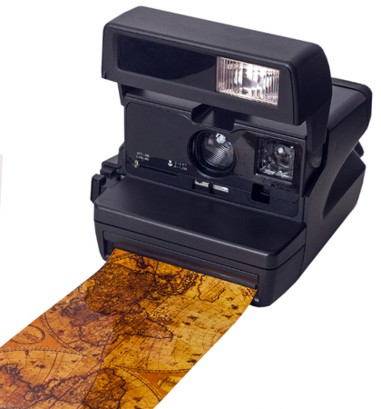 Vintage polaroid camera whith foto world map. Stock Photo