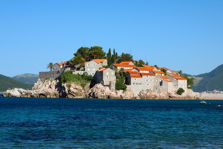 Sveti Stefan in daylight, view from beach photo