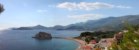 Panorama Sveti Stefan in the morning sunshine and calm seas photo