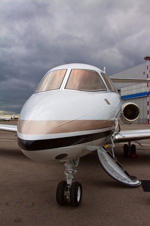 ladder in a private plane on the background of a cloudy sky photo