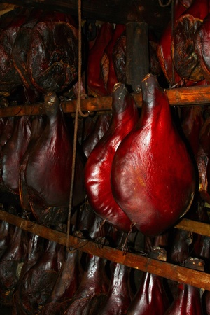 delicious smoked pork hanging in the smokehouse