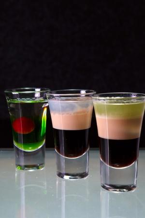 three layered: three cocktails layered shots Stock Photo