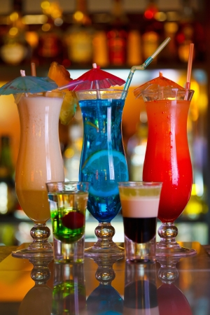 Cocktails Blue Lagoon, Pina Colada and Sunrise