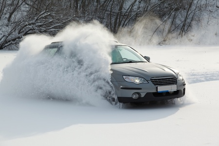 the car is moving rapidly over the smooth snow Stock Photo