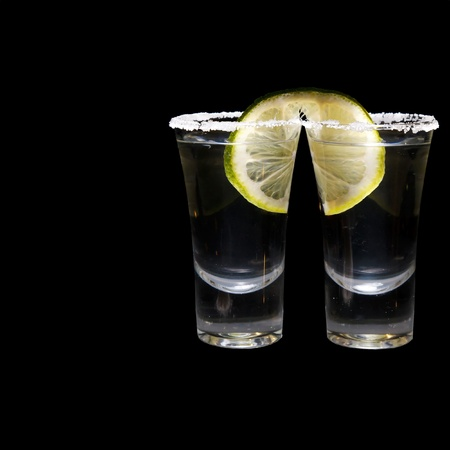 two shots of tequila with lime and salt Stock Photo