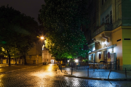 the old city of Lviv at night in the rain Stock Photo