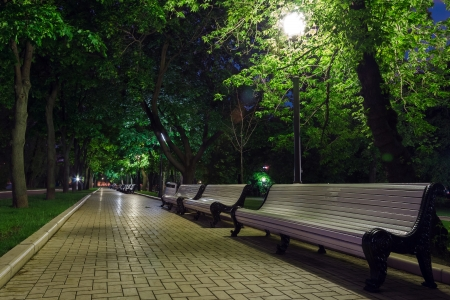 outdoor lighting: benches on the pavement in the light Stock Photo