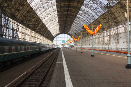 The iron arches and an empty platform on Moscow station early on a clear morning photo
