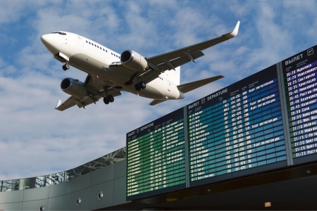 Airport flight information with the list of flights in the sky and the plane Standard-Bild