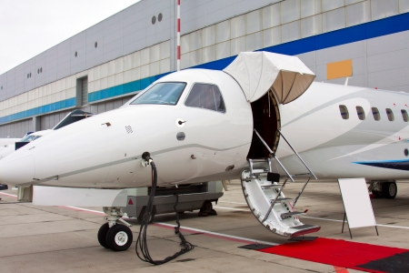 lowered ladder of a small private plane on the ground photo