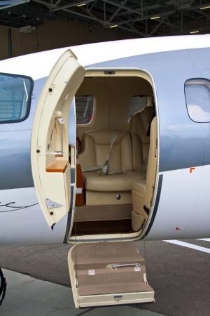 lowered ladder of a small private plane on the ground