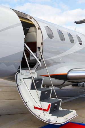 corporate jet: photo off ladder in a private jet Stock Photo