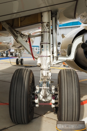 rear landing gear and jet engine passenger plane on the ground photo
