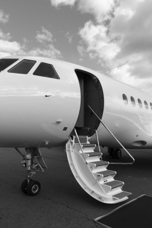 ladder in a private jet and red carpet on ground Stock Photo