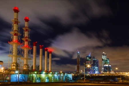 pipe plant at night in the light of lights and skyscrapers photo