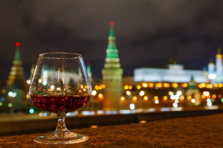 Moscow Kremlin night view from the waterfront and glass of brandy photo