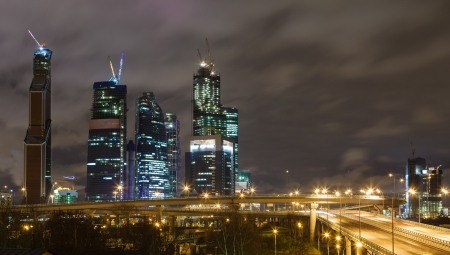 Night road and skyscrapers of Moscow against the sky photo