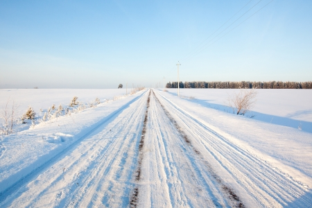 russian winter road and trees in snow blue sky Stock Photo - 18084718