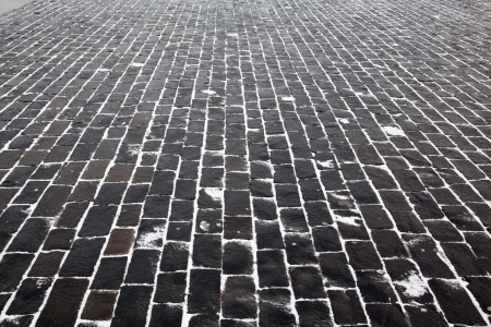 Close up cobblestone pavement in winter time photo