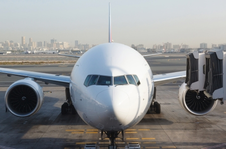 airplanes: Front view of airplane at gate Stock Photo