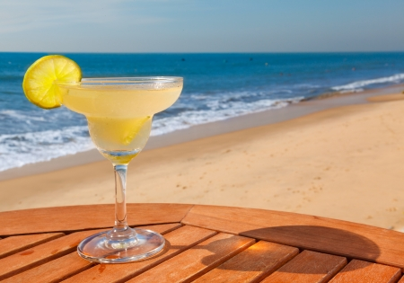 daiquiri cocktail with ice on the table against the background of sea and sky Stock Photo