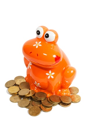 piggy frog and golden coins isolated on white background photo