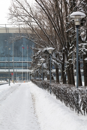 Moscow sidewalk with lanterns in the snow and the airport photo