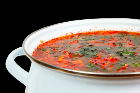 casserole with fresh hot borsch on a white background photo