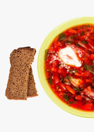 rye bread and a plate with fresh hot borsch isolated on a white background photo
