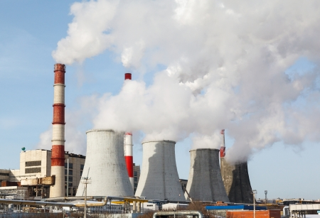 emissions: Smoking pipes of thermal power plant against blue sky