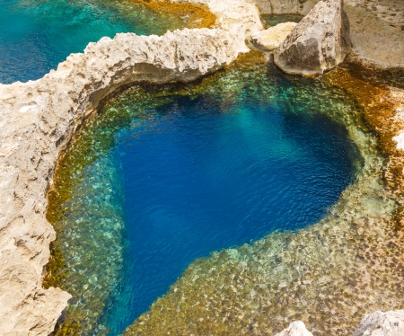 underwater cave in the form of heart at Azure Window in Gozo, Malta photo