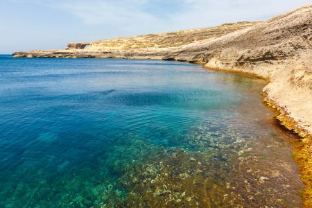 Azure Window and clear sea, famous stone arch of Gozo island in the sun in summer, Malta photo