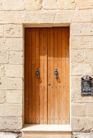 old wooden front door to the house in the Mediterranean photo