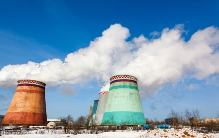 fuming: Smoking pipes of thermal power plant against blue sky