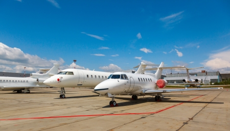 white private jets on the platform airport in the sun in summer Stock Photo