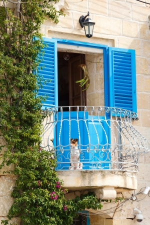 blue Window and balcony on ancient wall Mediterranean, Malta