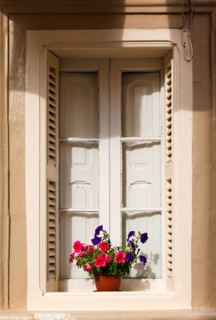 red geraniums on the window. Malta 2013 Stock Photo - 21782170