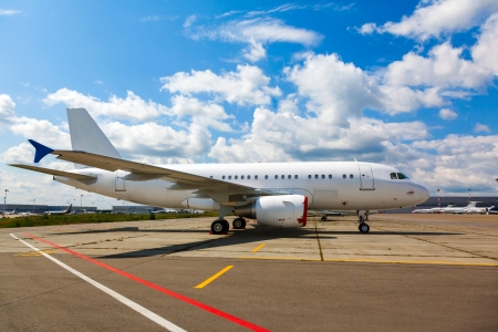 white aircraft on the platform airport in the sun in summer photo