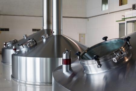 Steel fermentation vats on brewer factory