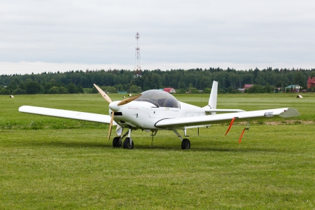 small wite airplane on the ground photo